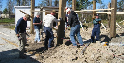 Green Valley Baptist Church sets the pilings for the new bunk house